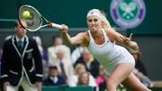 http://img171.imagevenue.com/loc814/th_230570211_Kristina_Mladenovic_Round1_Wimbledon_2013_013_122_814lo.jpg